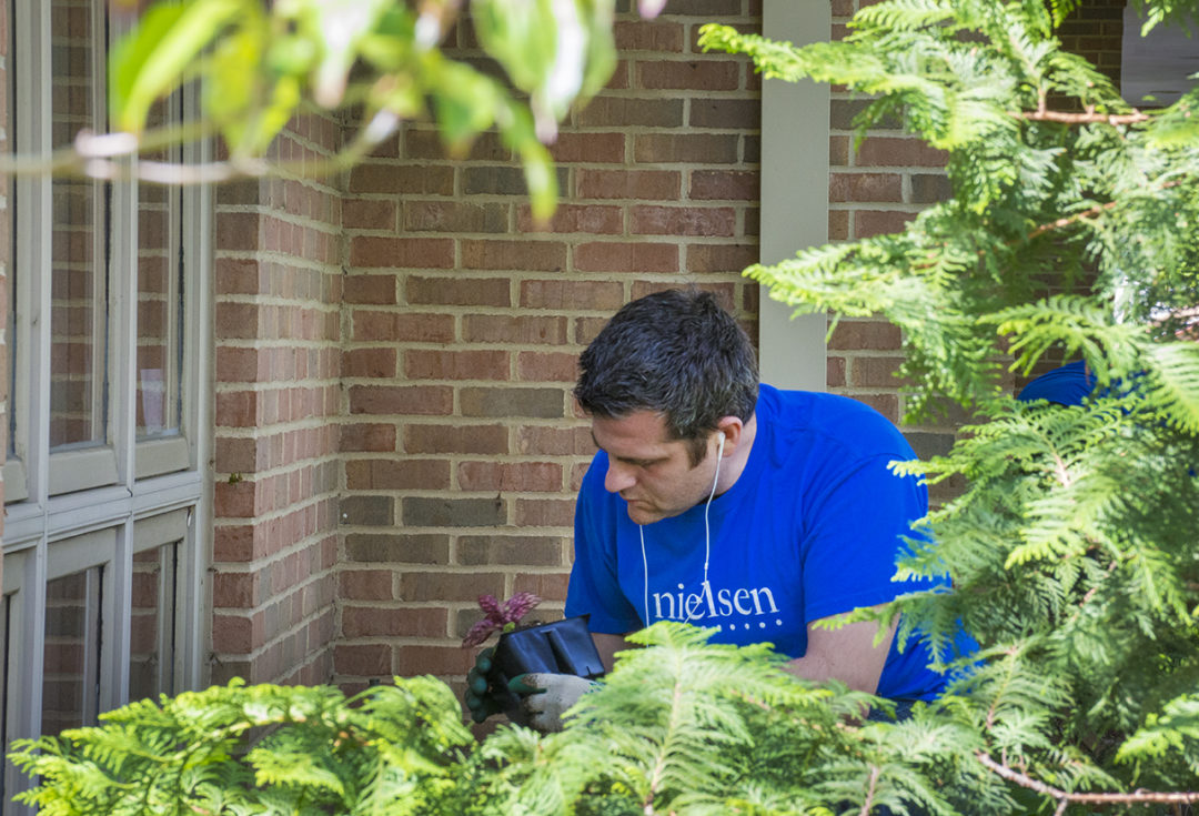 Volunteer plants plant at Ohio's Hospice of Dayton Hospice House