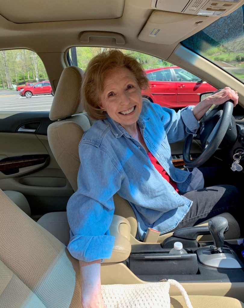 Susan Davis sitting in her car